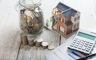Calculator,coins and house model